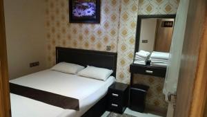 اتاق هتل مرمر مشهد