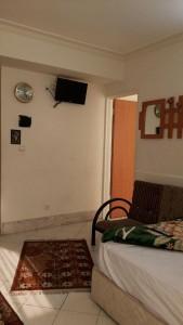اتاق هتل آپارتمان مهرگان مشهد